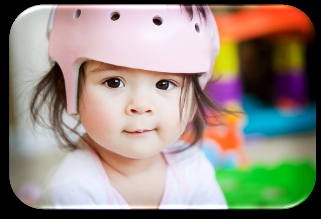 Young girl with a helmet on.
