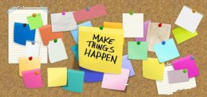 Bulletin Board with Make things Happen written on a note